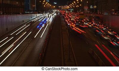 Long exposure night time lapse of urban traffic jam (4K...