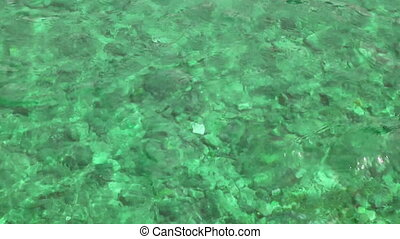 emerald water background in shallow - emerald water...
