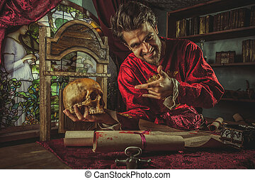 Smiling medieval grandee is pointing at the skull in the...