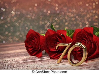 birthday concept with red roses on wooden desk. seventieth....