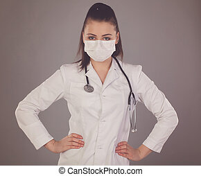 Gauze and woman - Nurse in gauze is against grey background...