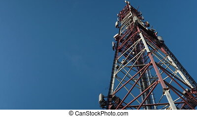 Cellular antenna tower and sky time lapse video clip