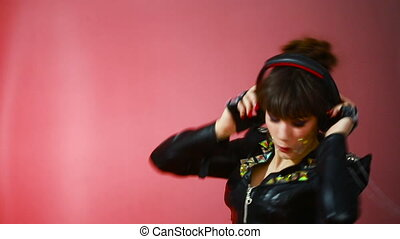 Hot beautiful girl like a dj woman dancing with headphones -...