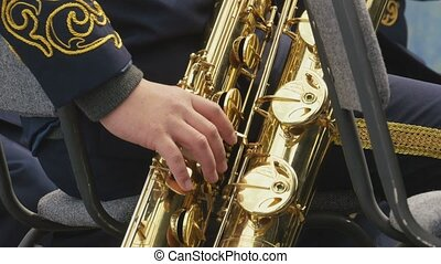 Musician playing the saxophone, closeup - Hands close-up...