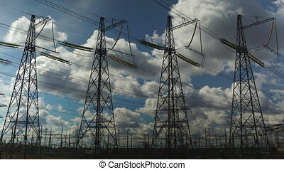 Power transmission line with cloudy sky on the background 4k...