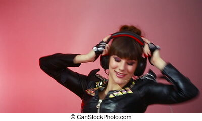 Hot beautiful girl like a dj. woman dancing with headphones
