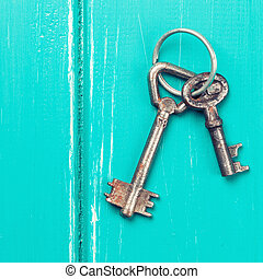old key on a blue wooden background