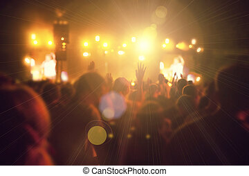 Silhouettes of people and musicians on big concert stage