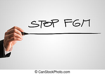 Handwritten sign - Stop FGM - Businessman writing a...