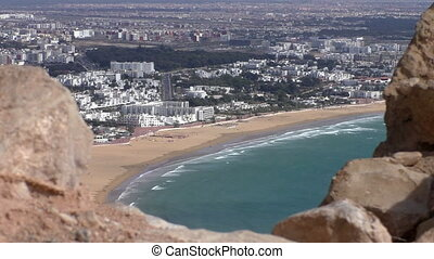 Old wall and Agadir city beach - New modern African Morocco...
