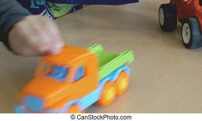 Two boys play toy model cars at the table - Two boy play toy...