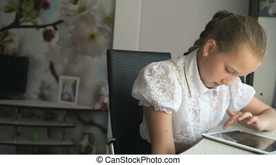 Teenager girl holding a digital tablet computer - Teenager...