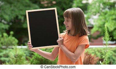 Girl with small blackboard