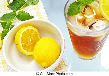 sliced lemons with fresh mint and iced tea (lemons are sharp)