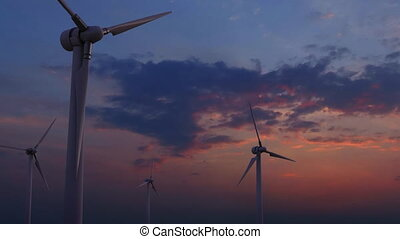 Four rotating wind generators against sunset blue and pink sky 4K dolly shot