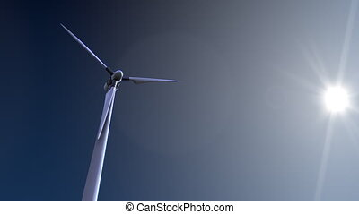 Single rotating wind turbine against blue sky and blazing sun 4K dolly shot