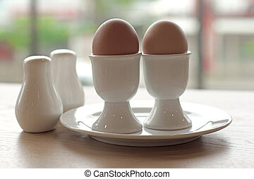 soft boiled egg in eggcup for breakfast meal