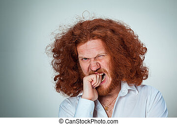 The Angry man - The angry young man with long red hair...