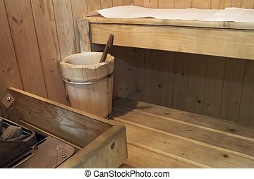 Sauna - Inside a wooden sauna, with wooden bucket