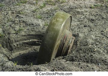 Anti-tank mine installing - Anti-tank mines at sand...