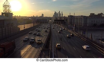 Road traffic and skyscrapers of Moscow city business...