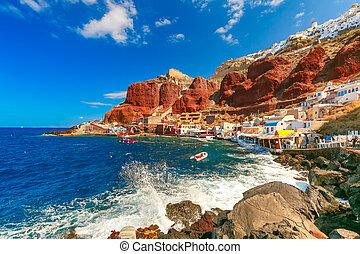 Port Amoudi of Oia or Ia, Santorini, Greece - The waves beat...