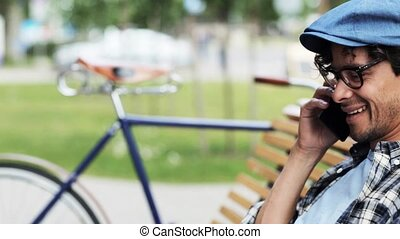 man calling by smartphone sitting on street bench 33 -...