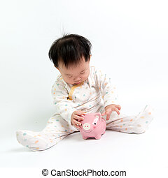 Asian baby with piggy bank - Portrait of Asian baby with...