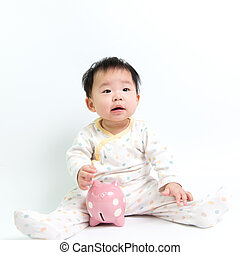 Asian baby with piggy bank