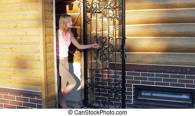 Woman locking door