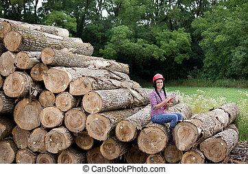 Lumber industry engineer - Young female lumber engineer...