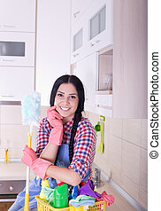 Woman with cleaning tools in kitchen