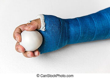 arm with blue cast is training with a ball