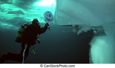 Scuba diving in Arctic at geographic North Pole. - Unique...