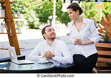 Business Team man and woman at Cafe having a conversation...