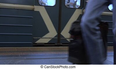 Departing Moscow metro train and passengers of mass transit...