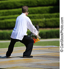 experienced master of martial arts Tai Chi is training with...