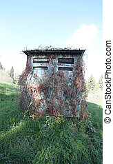 wooden hut for hunting in the mountains
