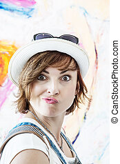 Crazy woman posing and pouting lips, beauty and fashion -...