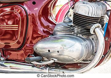 Detail of red veteran motorbike, meeting bikers - Detail of...