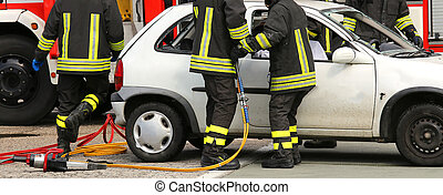 brave firefighters relieve an injured after a road accident