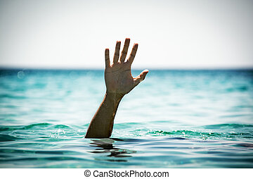 Help - Single hand of drowning man in sea asking for help