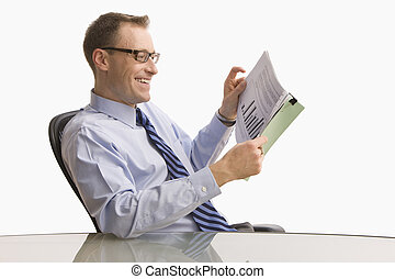 Businessman Looking at Paperwork - Isolated