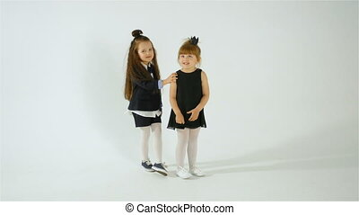 Two Shy Preschool Girls Posing On Camera, Kid Fun Concept,...