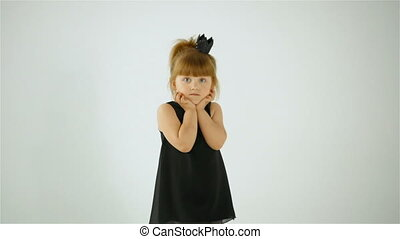 Cute Little Girl In Black Dress Sending a Kiss And Posing On Camera