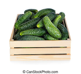 Cucumbers - Fresh ripe cucumbers in wooden box isolated on...
