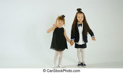 Cute Little Girls Wave At The Camera, Isolated On White...