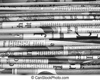 Newspapers - Detail of a pile of international newspapers