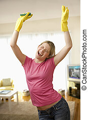 Young Woman Excited About Cleaning - Young woman with...