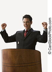 Businessman with Arms Raised - Isolated. - A young...